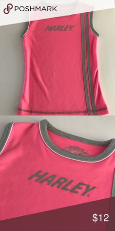 Harley Davidson Sleeveless Girl's Tee Size 6. In great condition. If you see more than 1 item you like, bundle them & I will send you an offer with a discount specifically for your bundle. Sorry, no trades. From a smoke free & pet free home. Harley-Davidson Shirts & Tops Tank Tops
