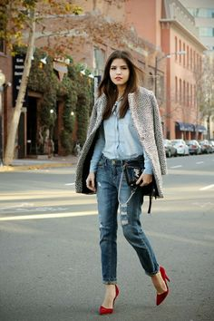 Warm coat with light blue check shirt with dark blue jeans and purse and red heels