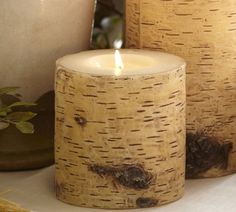 Dollar Tree LED pillar candle, wood patterned scrapbook paper and Mod Podge!