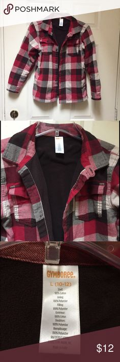 Thick layered flannel shirt Thick layered flannel shirt, you or your child will be toasty warm in this Gymboree flannel shirt. Youth size Large 10-12.  I am a small women & I van wear this but the arms are short for me. Boy/girl/women Gymboree Shirts & Tops Sweatshirts & Hoodies