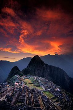 A striking sunset over the Lost City of the Incas; this sacred site was built in the 15th century at the height of the Incan empire. Artist: Galen Rowell Title: Sunset Over Machu Picchu, Peru Product