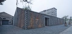 silk wall: parametric concrete blocks over an existing building, Archi Union Architects