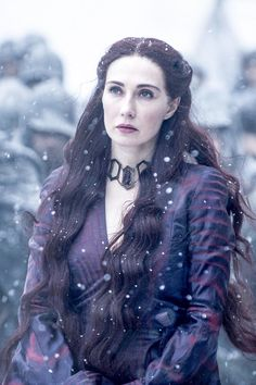"Melisandre, often referred to as The Red Woman, is a major character in the second, third, fourth, fifth and sixth seasons. She is played by starring cast member Carice van Houten and debuts in ""The North Remembers."" She is a priestess of the Lord of Light and a close advisor to Stannis Baratheon in his campaign to take the Iron Throne, but ultimately abandons him after her actions inadvertently lead to the destruction of his family and army and flees to Castle Black. Originally born a…"