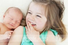 sibling pose - oh my goodness, too cute! I love the baby's sweet little smile.