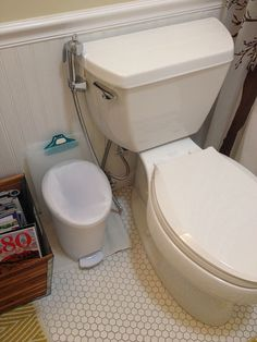 Using cloth diapers? Start here! Spray Pal diaper sprayer and shield set up in bathroom.