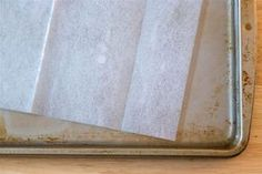 Spring cleaning hacks - use a dryer sheet to clean the stains off a baking sheet