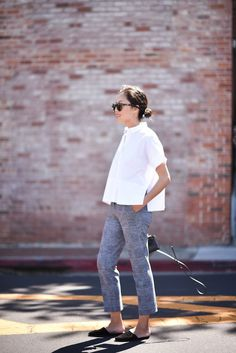 Anh from 9 to 5 Chic in the Everlane cotton poplin square shirt in white with a pair of houndstooth trousers and flats.
