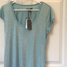 Aquamarine 100% Viscous  by Jeans By Buffalo Tee is so soft made of Viscose, aquamarine with silver embellishments. Tag say size small but works well for Medium Lady New never worn Jeans by Buffalo Tops Tees - Short Sleeve