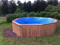 Huge swimming pool built with pallets step by step