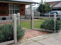 Nice example of a recessed entry gate on an ornamental welded wire loop fence. - Heritage Fencing