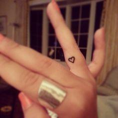 little heart tattoo on inside finger