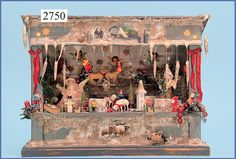 German Christmas market stall. Age not given.  Dimensions base plate 49 x 18 cm, height 37 cm.  It incorporates a music box playing  Silent Night.: