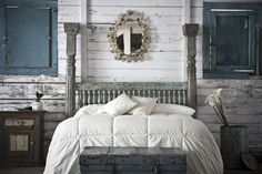 "Shot of ""the bed"" taken at the Hammond store that we use in ads, etc...  I love the distressed wood wall and blue shutters. All pieces hand selected by us in India.  www.discoveriesla.com"