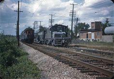 Two car train overtakes freight motor #3003 Chicago, Aurora & Elgin