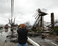 FRANK FRANKLIN II/APPUBLISHED: 10/29/2012 5:04:53  Hurricane Sandy damage in Belle Harbor, N.Y.  A man surveys the damage after a fire ripped through Belle Harbor, a beachfront neighborhood in Queens.