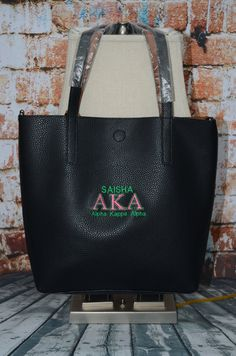 Alpha Kappa Alpha AKA Sorority Personalize Handbag - Monogrammed Embroidery Faux Leather Tote - Magnetic Closure bag - Personalized AKA Sorority Gift - Birthday gift Details: Alpha Kappa Alpha AKA Sorority Personalize Embroidered Monogrammed handbag that comes in a black. The faux leather is supe