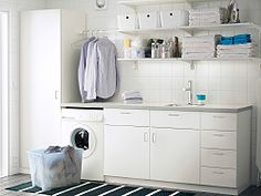 hanging rail above washing machine or leave baskets like now A laundry room with white wall shelves, base cabinets with doors or drawers and a high cabinet with shelves inside Laundry Room Shelves, Laundry Room Cabinets, Ikea Cabinets, Laundry Storage, Laundry Room Organization, Base Cabinets, Laundry Cupboard, Laundry Hacks, Laundry Table
