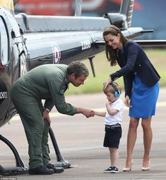 Prince George was quite the grown up as he shook hands with a pilot while his mother, the Duchess of Cambridge, looked on