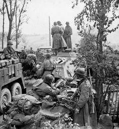 Battle-hardened Panzer grenadiers of the Waffen SS take a moment to rest in July on the Eastern front. These troops, belonging to the SS Panzer grenadier Division Totenkopf, or Death's Head, joined the advance on Leningrad in late June. Operation Barbarossa, Ww2 Pictures, Ww2 Photos, German Soldiers Ww2, German Army, Luftwaffe, Germany Ww2, War Photography, September