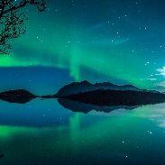 Autumn Equinoxe aurora over Kvaløya Island near Tromsø, Norway: