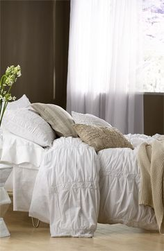 Saaremaa' Bedding Bundle.....Easy elegance infuses a neutral-toned bedding set that includes a crisp cotton duvet cover, matching shams and a cozy knit blanket. Three complementary pillow covers styled with shabby-chic texture and crisp stripes finish out the breezy-chic bundle.        Pillow inserts and sheets sold separately.      Includes duvet cover, two shams, one blanket and three decorative pillow covers.