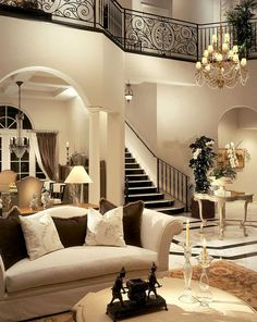 Traditional  and modern at the same time with pretty light earth tones with white and black and glassey and huge