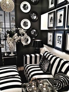 Amazing Old Hollywood Living Room Decor With Black And White Stripes Velvet Sofa Feat Black Granite Stand Flooring Light Complete With Stripe Ottoman Combine Hollywood Celebrity Photo Decor And Unique Round Glass Pendant Light Ideas of Contemporary Old Hollywood Decorated  Vintage Hollywood Decorating Ideas Old Hollywood Glamour Decor Old Hollywood Decor Party Classic Hollywood Decor Hollywood Glam Dresses . 700x932 pixels