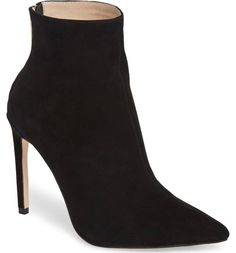 A striking setback heel and contoured shaft add to the modern, of-the-moment look of a pointy-toe bootie in lush suede.