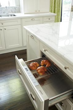 Warming Drawer is a must when everyone has a crazy schedule. They're also nice when you host parties & events, to refresh the food periodically.