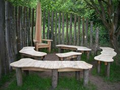 Storytelling area in the corner of a local junior school playground. Screen and benches made from locally coppiced sweet chestnut. Throne chair made from Douglas Fir offcuts from local sawmill.