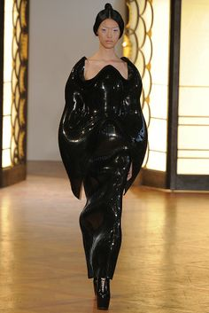 Sculptural Fashion - glossy black dress with engulfing contours; fashion meets science fiction; alien creations // Iris van Herpen