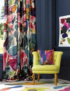 Love the idea of bright curtains and furniture with dark walls.
