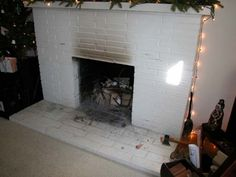 Reader wants to know how to remove bricks and hearth from her old fireplace and replace them with tile. Photo: From Reader