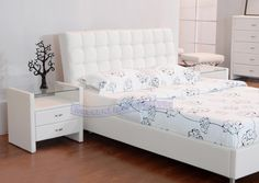 bed with white leather headboard