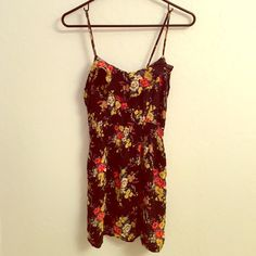 Flower print summer dress! Fun and flirty flower print dress. Elastic underneath the bust. I'm 5'5'' and it goes to about mid thigh. Right strap was ripped but sewn back together (pictured). Not noticeable at all. Very light and cute for a summer concert or day at the beach Dresses Midi