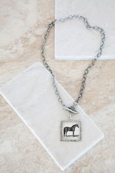 Vintage Horse & Wrapped Toggle Silver Plated Pendant. This lovely horse jewelry is handmade in the US by Ornata Jewelry. You won't find anything quite like this. | Collage from 1700's text and an 1800's illustration of a black Arabian horse. Symbolic meanings associated with horses include passion, freedom, life energy, and personal drive.