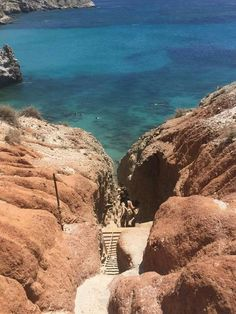 Tsigrado, Milos island - Tsigrado, is situated at the bottom of a rocky hill and can only be accessed by shimmying down a rope).