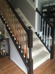 I finally tackled those outdated ugly orange oak stair banisters! What a difference it makes, right? It really is very easy to do, and it. Painted Stair Railings, Black Stair Railing, Painted Staircases, Staircase Railings, Painted Stairs, Banisters, Staircase Design, Stairways, Banister Ideas