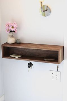 Our Floating Entryway Organizer is handmade from a single hardwood plank, highlighting a continuous wrap-around grain. Choose from Walnut, White Oak or Maple. We source the highest quality domestic hardwood. Never stained-- No cheap Pine! Available in 4 lengths, this floating shelf mounts