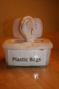 Reusing Baby Wipes Containers to Store   Plastic Bags. Tired of all the piles of plastic bags lying around your house?   Tired of trashing your old baby wipe containers? Here's a great way to keep your   plastic bags organized without spending a penny! This would be perfect for   taking on camping trips!