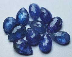 10 Pcs,Super Finest, Super Rare,TANZANITE Faceted Pear,   Product name : TANZANITE BLUE Description : TANZANITE Micro Faceted Rondells  Size :