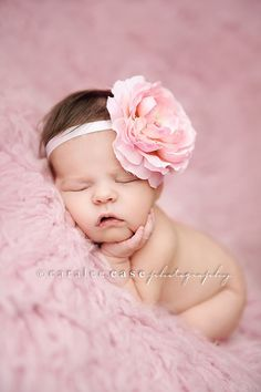 Pink flower, pink headband, pink fur with newborn