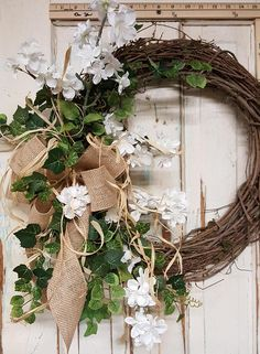 Handmade item Materials: grapevine wreath, glue, wire, wired burlap, realistic fern, realistic greenery, white flowers, wedding flowers, rustic, vintage Made to order Ships from United States Questions? Contact shop owner Item details Wreath for Front door. This beautiful burlap