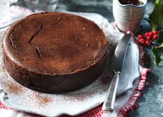 Baked chocolate cheesecake studded with spiced Christmas pudding on a bourbon biscuit base