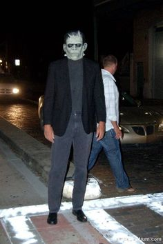 Frankenstein stops in the middle of a crosswalk to pose for a picture during Guavaween 2012.