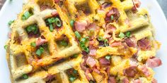 Savory low carb waffles made with almond flour, eggs, ham, and shredded cheddar cheese. Seasoned with salt, pepper, and chives. The perfect breakfast.