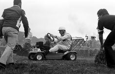 Sir Stirling Moss competing in a lawnmower race, 1975.