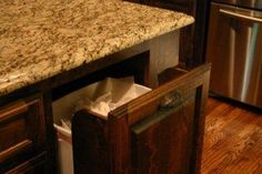 Things to include when building a house: garbage in a drawer under island or other countertop workspace for easy cleanup.