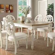 "Gather friends and family in classic style around this lovely dining table, showcasing turned legs and a 2-tone finish.  Product: Dining tableConstruction Material: Select hardwoods and elm wood veneersColor: Antique white and oakFeatures:  Carved accentsTurned legsDimensions: 30.25"" H x 82"" W x 42"" D"
