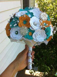 Handmade bouquet (/u/zedfucon) http://www.reddit.com/r/weddingplanning/comments/1feij8/finally_finished_by_bouquet_a_day_before_my/ca9iwjy